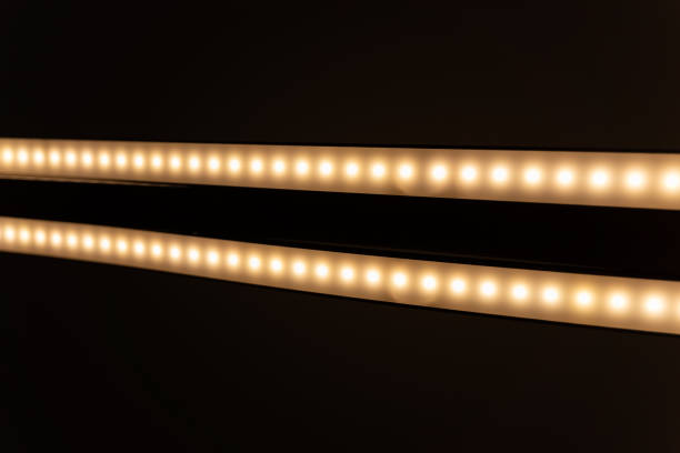 LED light with two tubes taken from below with the camera.(Weak reflection of the metal tube) stock photo