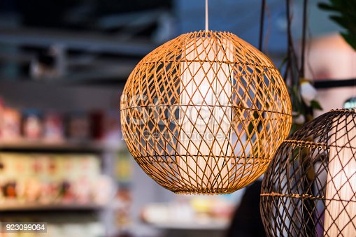istock Light woven round lamp, made of light wood or bamboo material 923099064