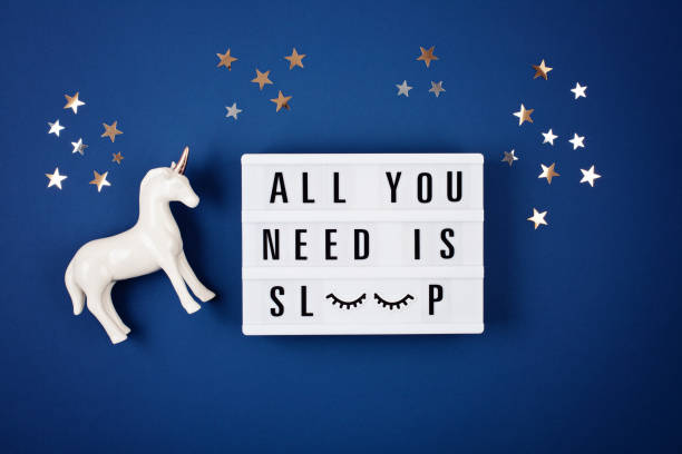 lightbox with quote all you need is sleep - unicorn bed imagens e fotografias de stock