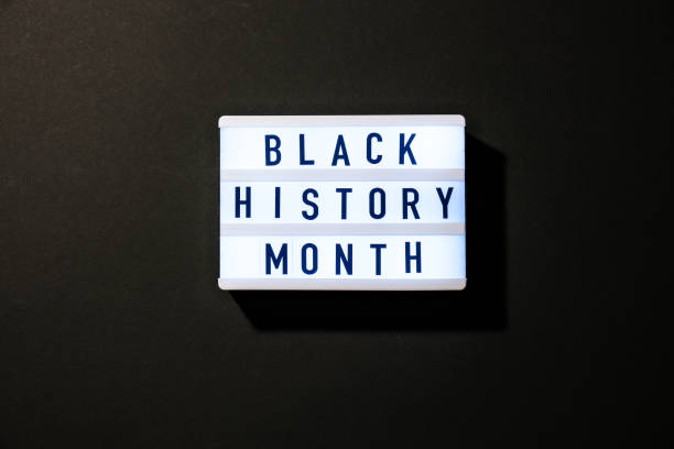 Lightbox with text BLACK HISTORY MONTH on dark black background. Message historical event stock photo