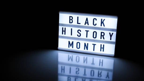 Lightbox with text BLACK HISTORY MONTH on dark black background with mirror reflection. Message historical event Lightbox with text BLACK HISTORY MONTH on dark black background with mirror reflection. Message historical event. Light black history month stock pictures, royalty-free photos & images