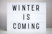 """istock lightbox with text """"winter is coming"""" on the table 1276573918"""