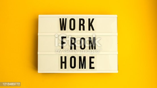 lightbox with text WORK FROM HOME in front yellow background, copy space, banner for freelance coronavirus quarantine isolation, teleworking