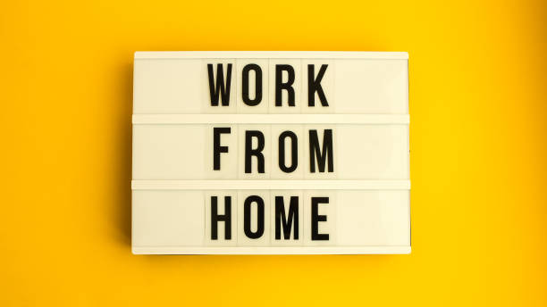 lightbox with text WORK FROM HOME in front yellow background, copy space, banner for freelance coronavirus quarantine isolation stock photo