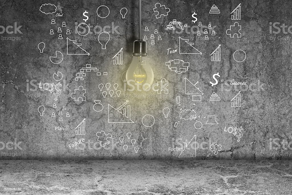 Lightbulb and icons on dirty wall stock photo