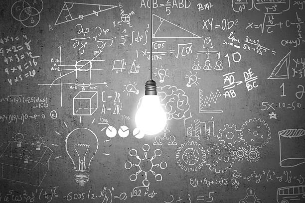 lightbulb and mathematical symbols on dirty wall - formula 1 個照片及圖片檔