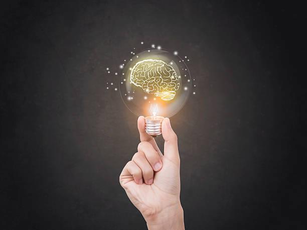 lightbulb brainstorming creative idea abstract icon on business hand. - 專長 個照片及圖片檔