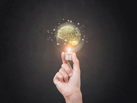 Photo libre de droit de Lightbulb Brainstorming Creative Idea Abstract Icon On Business Hand banque d'images et plus d'images libres de droit de Abstrait