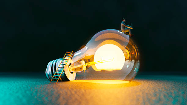 Lightbulb concept with man sitting on top of it an getting great ideas stock photo