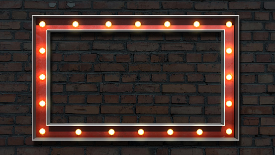 Image of lightbulb lettering on a brick wall background