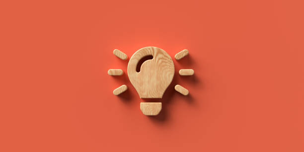 lightbulb icon on orange background, rendered in 3D stock photo