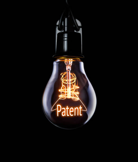 Lightbulb Patent concept. Hanging lightbulb with glowing Patent concept. intellectual property stock pictures, royalty-free photos & images