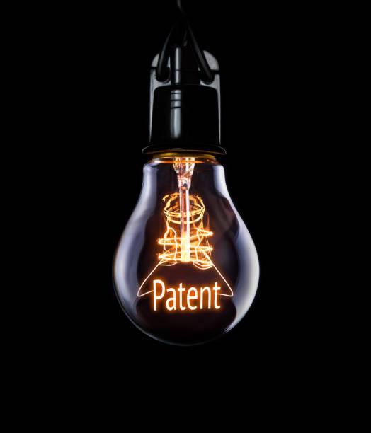 concept de brevet de l'ampoule électrique. - marque déposée photos et images de collection