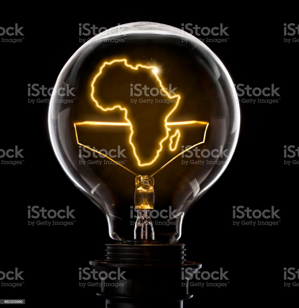 Lightbulb with a glowing wire in the shape of Africa (series) stock photo