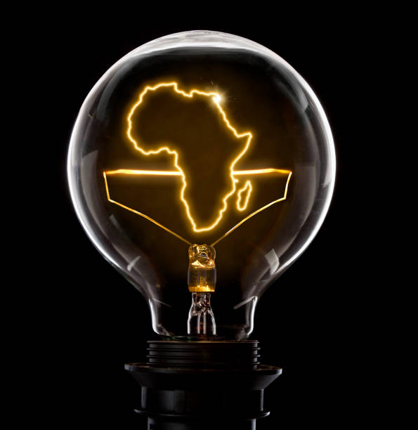 Lightbulb with a glowing wire in the shape of Africa (series) - foto stock