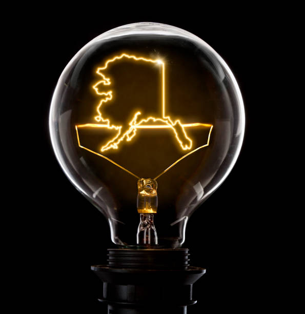 Lightbulb with a glowing wire in the shape of Alaska (series) - foto stock