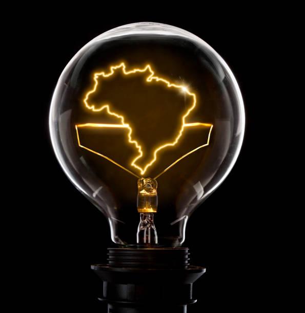 Lâmpada com um fio brilhante em forma de Brasil (série) - foto de acervo