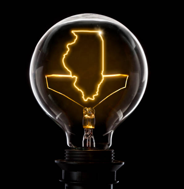 Lightbulb with a glowing wire in the shape of Illinois (series) - foto stock
