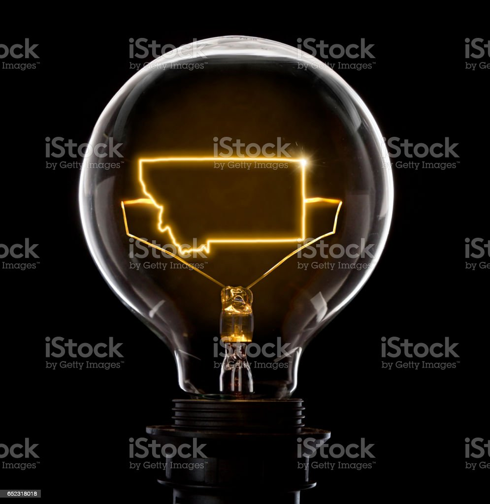 Lightbulb with a glowing wire in the shape of Montana (series) stock photo