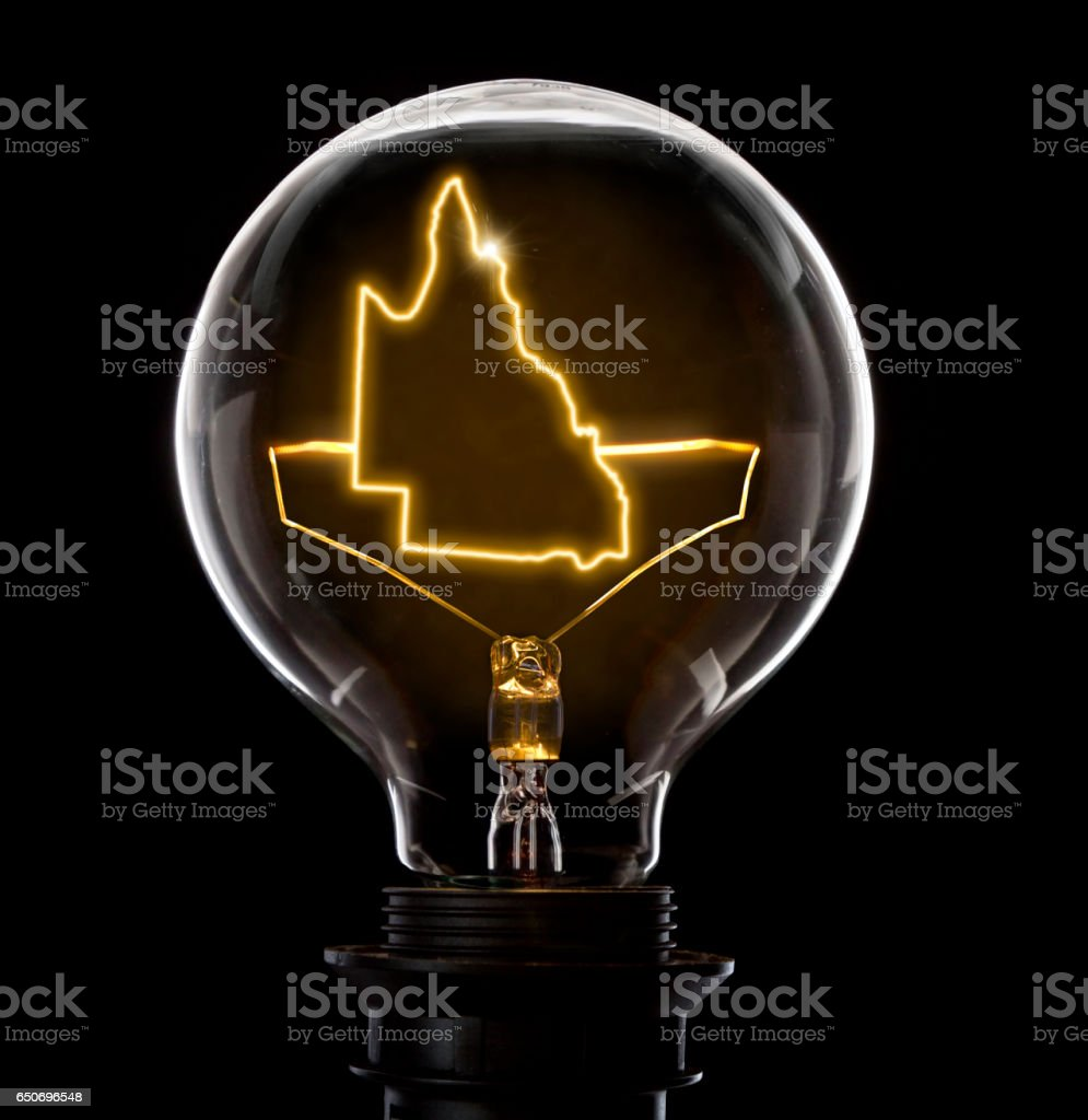 Lightbulb with a glowing wire in the shape of Queensland (series) stock photo