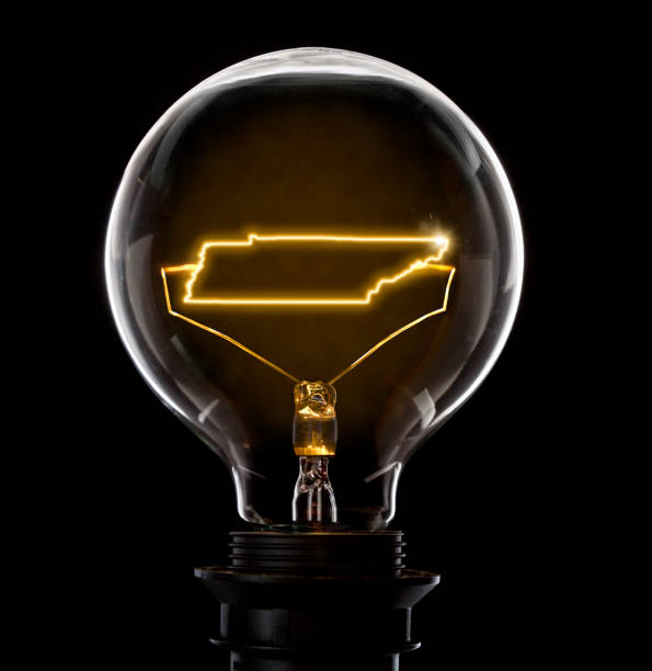 lightbulb with a glowing wire in the shape of tennessee (series) - tennessee map stock photos and pictures