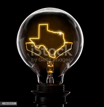 istock Lightbulb with a glowing wire in the shape of Texas (series) 652320336