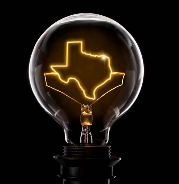 glühbirne mit einem glühenden draht in der form von texas (serie) - erfinder der fotografie stock-fotos und bilder