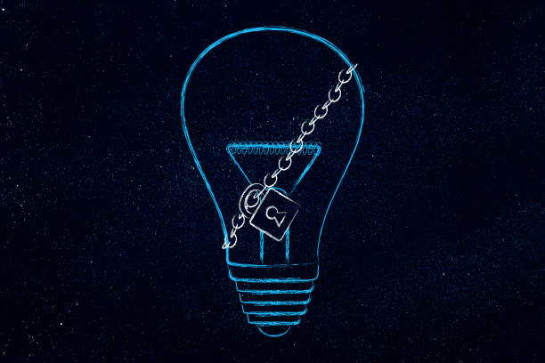 lightbulb with lock and chain stock photo