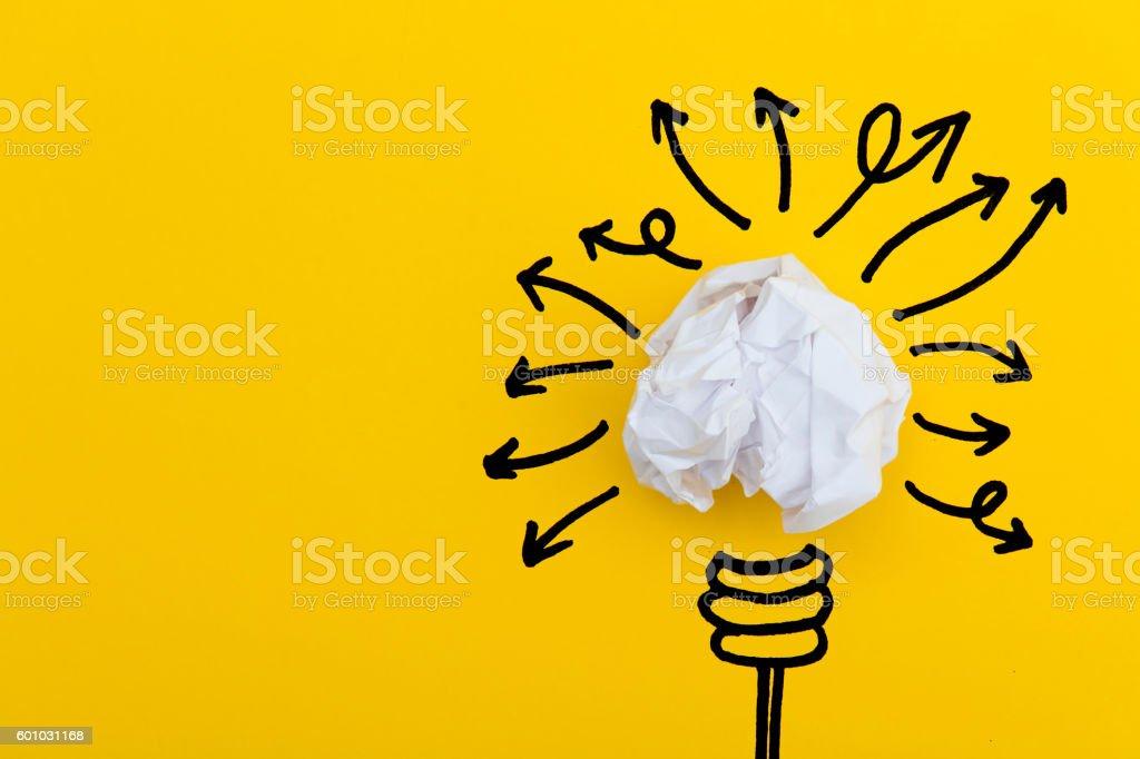 Lightbulb with many arrows stock photo