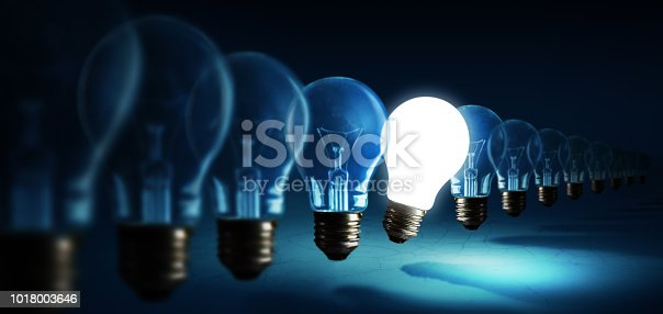 istock Lightbulbs on blue background, idea concept 1018003646