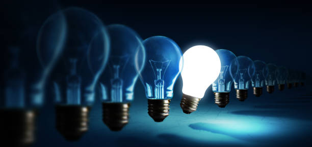 lightbulbs on blue background, idea concept - light bulb stock pictures, royalty-free photos & images