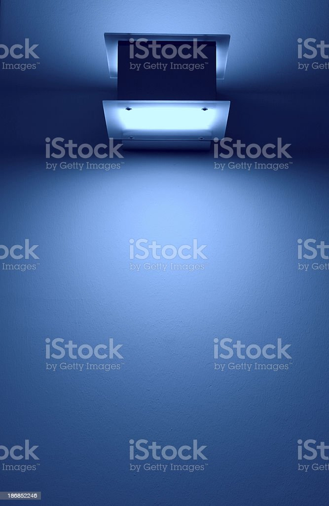 lighted blue wall with copyspace stock photo