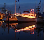 Lighted boats in the harbor at Christmas time
