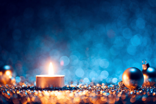 istock A lighted candle with Christmas balls at the sides 187447582