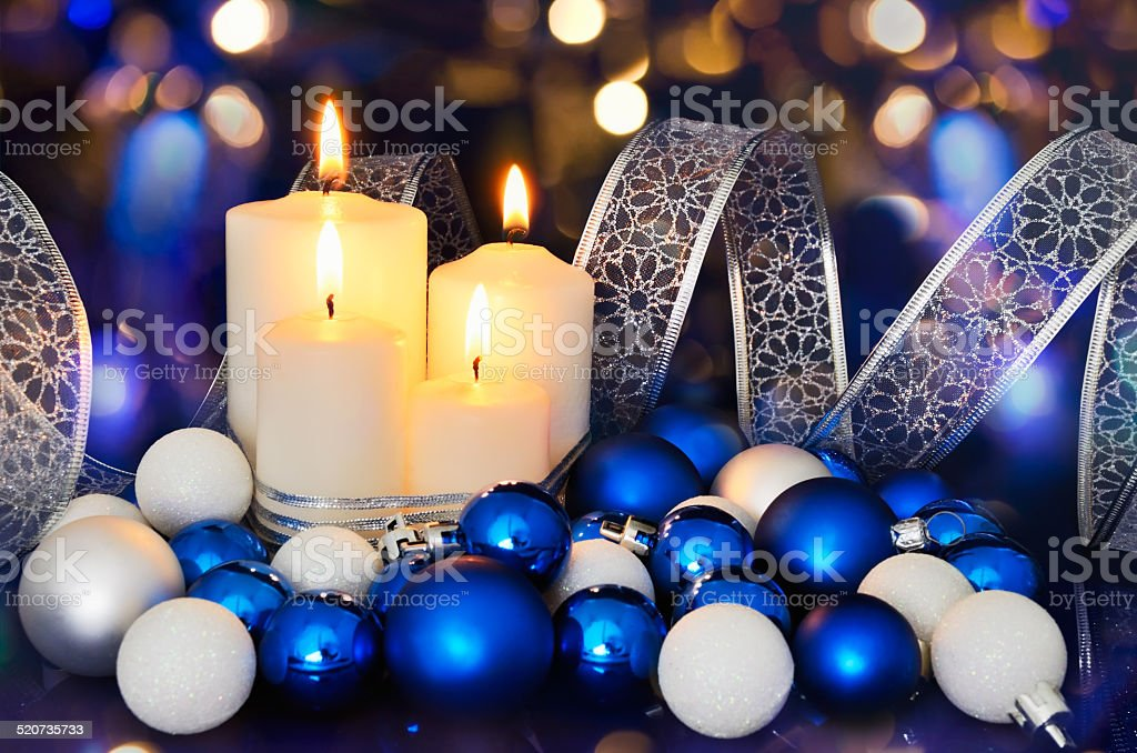lighted candles and blue white christmas tree decorations on the royalty free stock photo