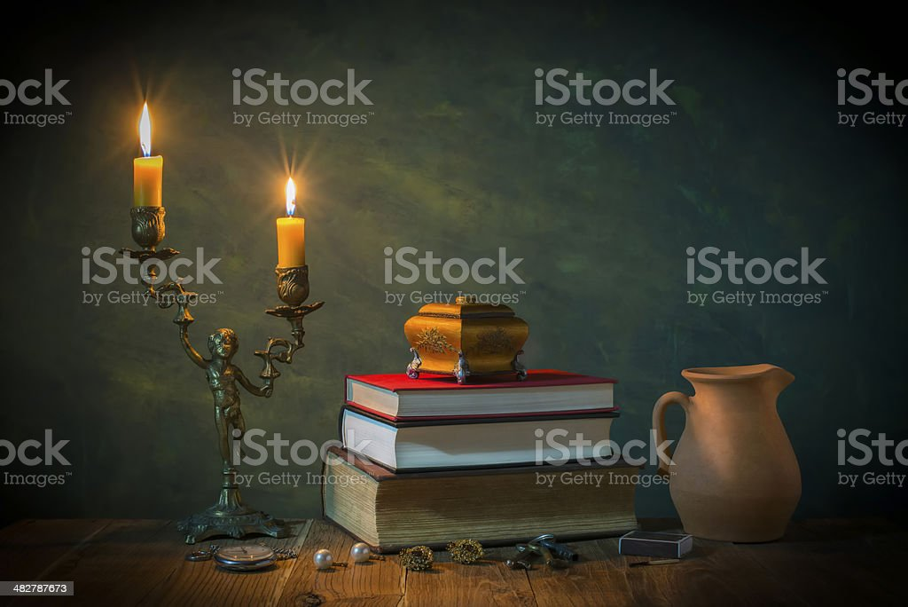 Lighted candles and books stock photo