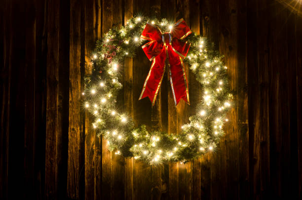 Lighted Christmas Wreath on Old Barn