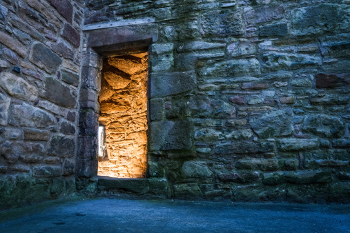 Lighted dorway to the ancient castle