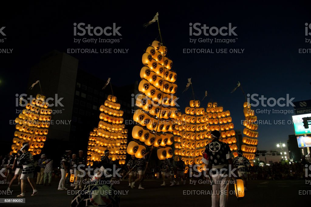 Lighted floatings are in the sky in Kanto festival stock photo