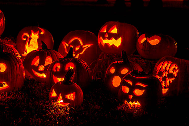 Lighted Halloween Pumpkins with Candles stock photo