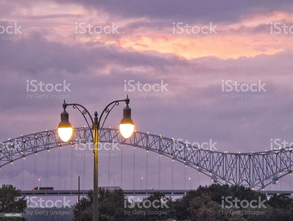 Lighted Lamppost and Bridge Around Sunset in Memphis, Tennessee royalty-free stock photo