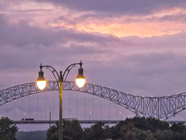 Lighted Lamppost and Bridge Around Sunset in Memphis, Tennessee stock photo