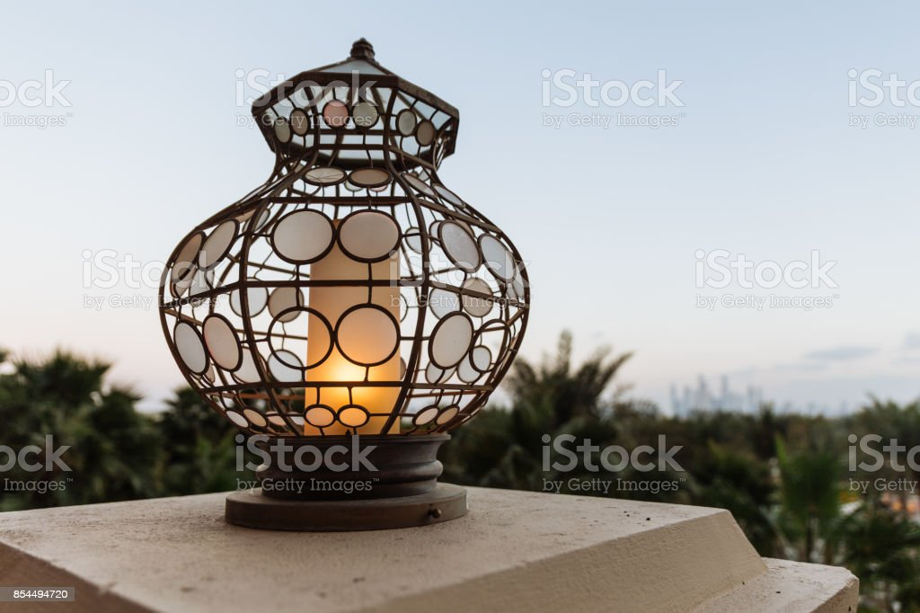 Lighted outdoor lamp decorated with Arabic circle pattern at hotel...