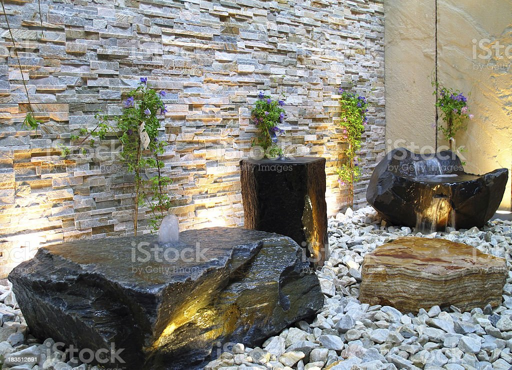 Lighted stone fountain stock photo