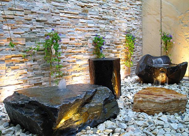 beleuchtete steinbrunnen - indoor wasserbrunnen stock-fotos und bilder