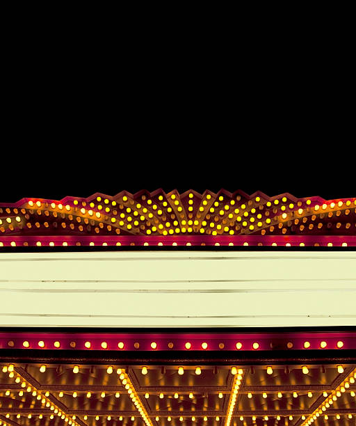 Lighted Theater Marquee at night with copy space areas A bright theater marquee with glowing yellow light bulbs. There is a dark starry night sky in the background. The marquee area is blank so that you can easily add your own text. The large black area in the sky is perfect for copy on the top portion of the image.  theater marquee commercial sign stock pictures, royalty-free photos & images