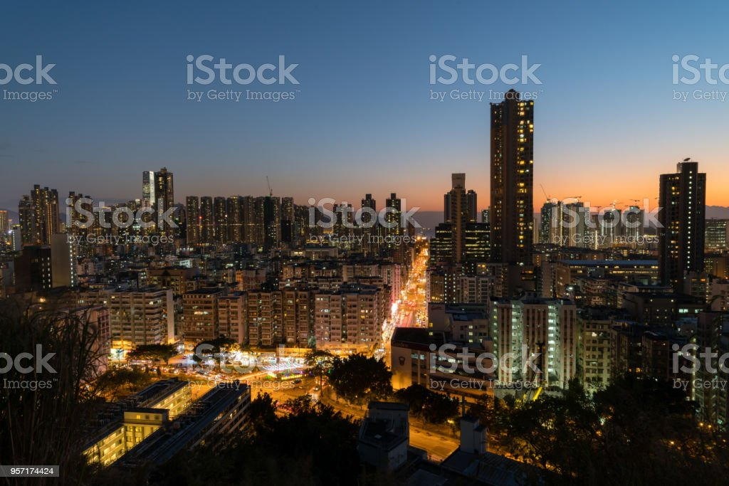 lighted up Sham Shui Po during dusk stock photo