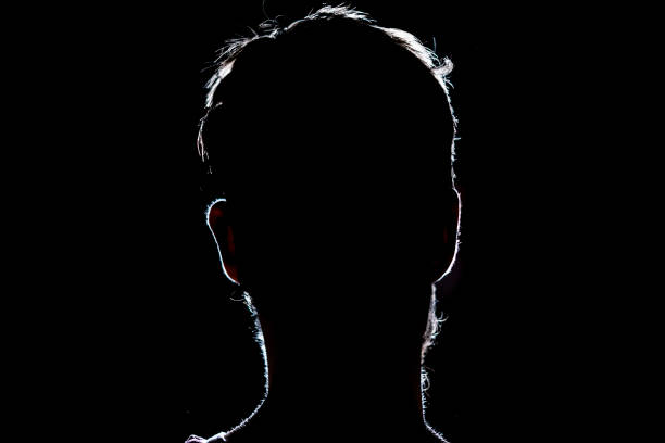 lighten portrait silhouette of a human head in the dark  background lighten portrait silhouette of a human head in the dark  background unrecognizable person stock pictures, royalty-free photos & images