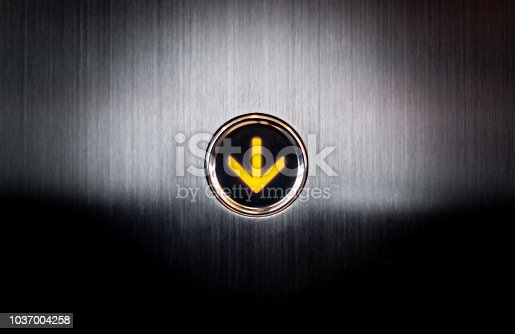 istock Lighten up going down button for Lift Elevetor 1037004258