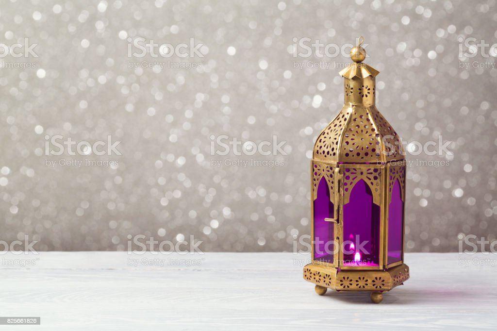 Lightened lantern on wooden table over bokeh background. Ramadan kareem holiday celebration concept stock photo